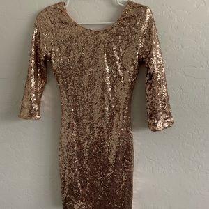 Sparkly rose gold dance dress.